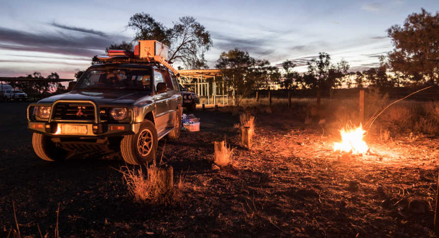 A Mitsubishi Pajero as a campervan by a campfire in Australia.