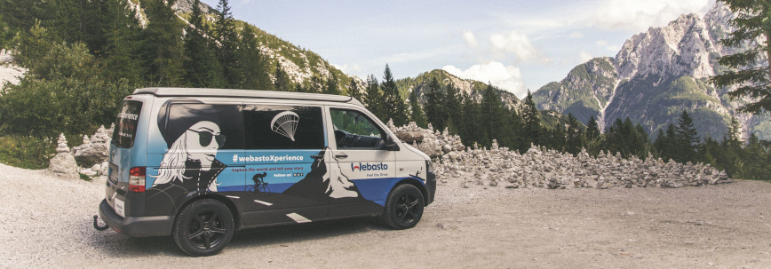 WebastoXperience Bus in front of the beautiful mountain scenery in Slovenia